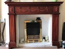 Dark wood decorative fire surround
