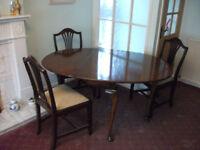 Polished Dining Table and 3 chairs.