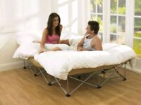 Inflatable double bed with raised stand. Folds up & fits into a carry bag with wheels. electric pump