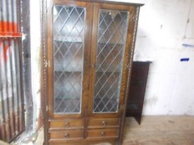 A leaded glass bookcase/display unit