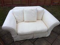 2 seater cream fabric sofa. W170cm, D100cm.