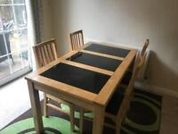 Wooden dining table with granite inserts and 4 chairs