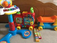 V-Tech ride on and Piano toy bundle