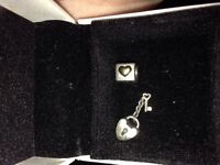 2 pandora charms both gold and silver