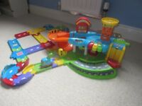 Vtech toot toot drivers garage, extra tracks and tow truck.