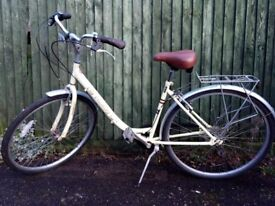 Modern yellow/cream city bike, dutch vintage style, with a rack & mudguards, lovely ride, 7 gears