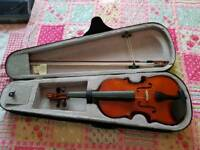 Violin in the case with a bow