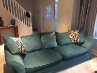 Large comfy teal sofa