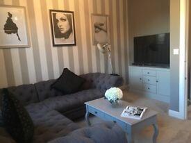 Large buttoned corner sofa