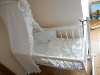 Crib, white wood, swing or static option with new mattress, 'Broderie anglaise' hood, bumpers, etc.