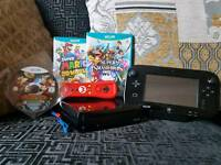 Wii U + 2 games + extra controller