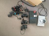 PlayStation 1 and 2 with tonnes of games, karaoke sing star mics and controllers.