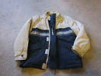 Boys cream and navy waterproof jacket. Aged 7-8.