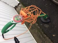 Used Electric strimmer works perfect new strimmer line in it and a spare roll
