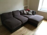 Corner sofa with foot stool. In good condition.
