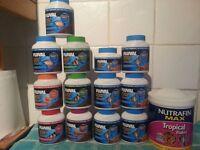 Job Lot of 14 Tubs of Tropical Fish food / flake and pellets . a bargain !!!!