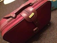Carlton red suitcase