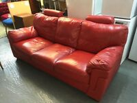 RED LEATHER THREE SEATER SOFA