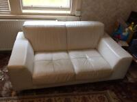 Used white leather two seater sofa