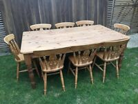 Stunning traditional large farmhouse pine dining/kitchen table with eight chairs.