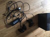 Xbox 360 console with two controllers