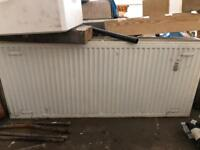 Double radiators white 4 large 1400x600mm 1 small 400x600mm