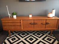A beautifully designed & crafted 1960s teak sideboard manufactured by Jentique of Great Britain.
