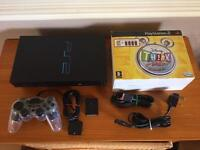 PlayStation 2 console with Disney buzz game. Ps2