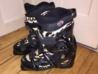 2 pairs of ski boots, both Rossignol.