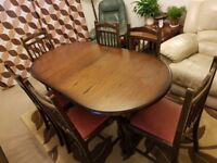 Wooden, family, large and extentable dining table with six matching chairs.