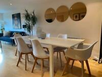 Full dining set in white. Table and chairs.