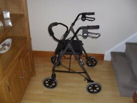 ROLLALONG DISABLED SEAT WITH WHEELS AND FOOT PLATES