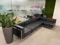 Black leather sectional sofa. Perfect for office spaces!