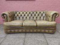 A Light Green Serpentine Leather Chesterfield Three Sofa Sofa