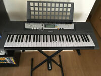 Yamaha EZ-200 61 Lighted Keyboard Electric Digital Piano with Bench, Stand and Pedal