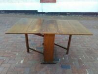 Solid oak old country dining table. Gate leg on both sides. Will seat 8.