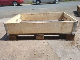 Wooden euro pallet surround metal hinged joints.