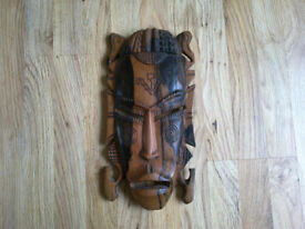 Hand-carved wooden mask from Cameroon