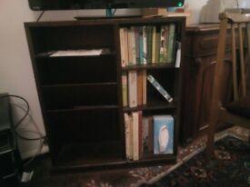 Bookcase includes newspaper rack