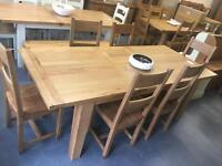 1.8m extending to 2.3m oak dining table