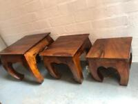 Set of four hand carved distressed hardwood nest of tables