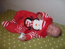 Weighted newborn baby doll