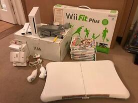 Nintendo Wii console, 10 games, charging station and Wii Fit Board
