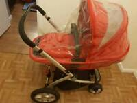 Red Mothercare pram with accessories