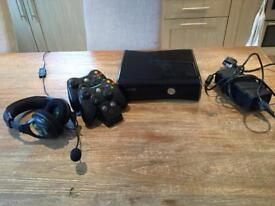 Xbox 360 with 2 controllers, charger and headphones - 8 games