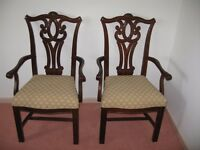 2 solid wood carver chairs hardly used
