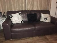 Brown leather three seater sette in good condition