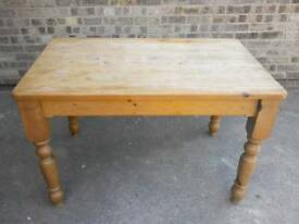Pine kitchen table in used condition.