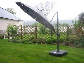 Luxury Overhanging parasol with LED rib lights. 360 degree swing and full Onetouch tilt.