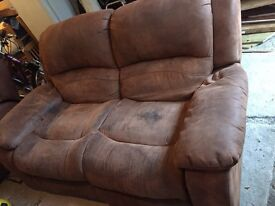 Two brown suede leather two seater sofas